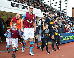 BIRMINGHAM, ENGLAND - Easter Sunday, March 31, 2013: Liverpool's captain Steven Gerrard walks out with mascot Jashua Jackson before the Premiership match against Aston Villa at Villa Park. (Pic by David Rawcliffe/Propaganda)