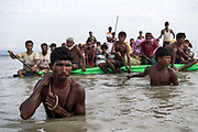 Sunday 12th November 2017. After 16 - 20 days waiting on the Myanmar border, Rohingya refugees cross the Naf River into Bangladesh using eight makeshift rafts made out of bamboo and plastic palm oil containers. <br />