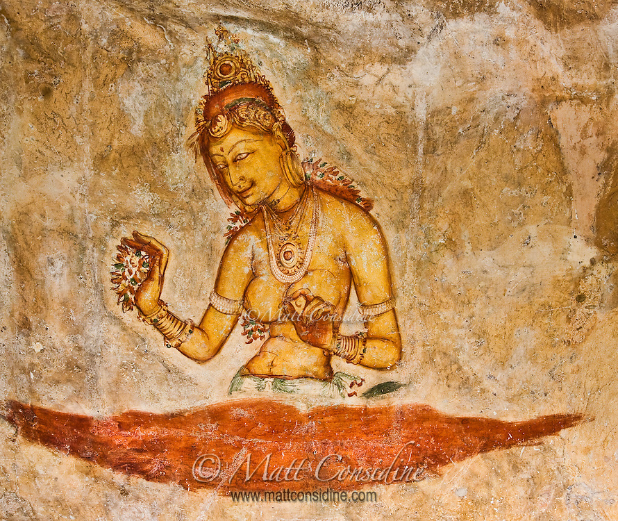 Monks painted angelic women half way up the face of a sheer cliff face fifteen hundred years ago.  The overhanging cliff face has protected them from the elements.<br /> (Photo by Matt Considine - Images of Asia Collection)