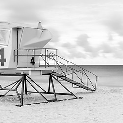 Pensacola Beach lifeguard tower four on Casino Beach. Pensacola Beach Florida is on Santa Rosa Island in the Emerald Coast area of the Southeastern United States of America. Photo is black and white with a 1:3 panoramic ratio. Copyright ⓒ 2018 Paul Velgos with All Rights Reserved.