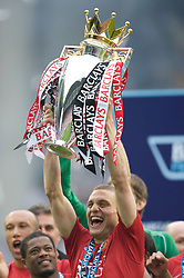 WIGAN, ENGLAND - Sunday, May 11, 2008: Manchester United's Nemanja Vidic lifts the trophy after winning the Premier League for the 10th time after the final Premiership match of the season at the JJB Stadium. (Photo by David Rawcliffe/Propaganda)