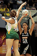 08.07.2011 Amanda Mynhardt of South Africa(left) goes in for the block on Maria Tutaia of New Zealand during the Quarter-finals between New Zealand and South Africa, Mission Foods World Netball Championships 2011 from the Singapore Indoor Stadium in Singapore.