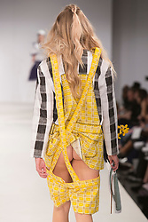© Licensed to London News Pictures. 01/06/2015. London, UK. Collection by Dahye Jee. Fashion show of Nottingham Trent University at Graduate Fashion Week 2015. Graduate Fashion Week takes place from 30 May to 2 June 2015 at the Old Truman Brewery, Brick Lane. Photo credit : Bettina Strenske/LNP