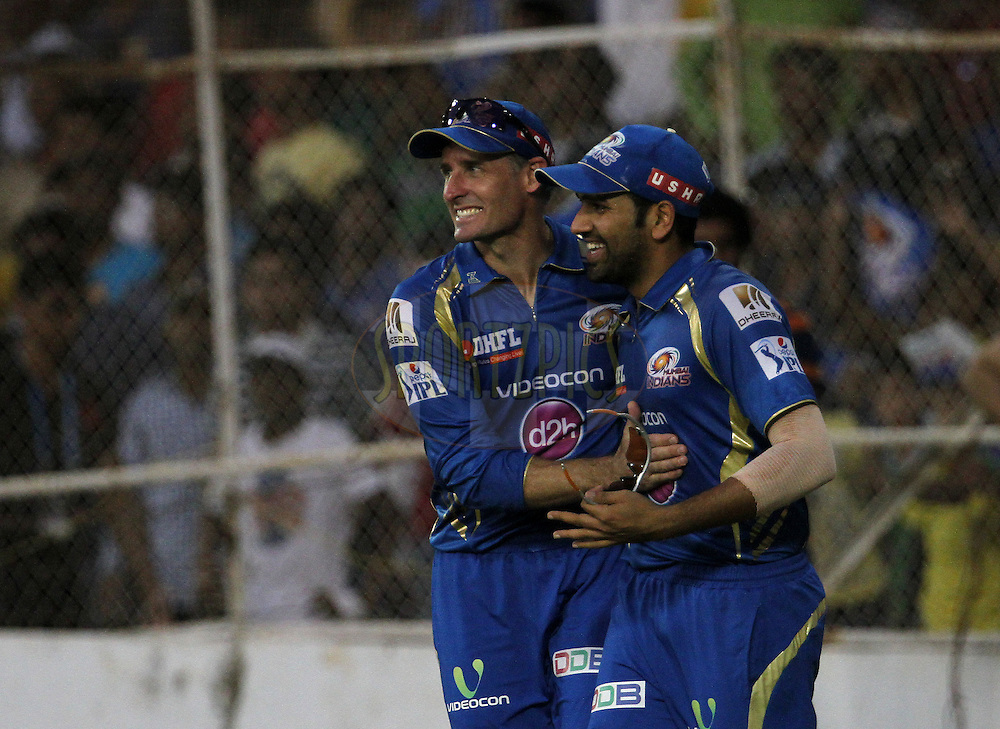 Rohit Sharma captain of the Mumbai Indians and Michael Hussey of the Mumbai Indians celebrates the wicket of Brad Hodge of the Rajasthan Royals during match 44 of the Pepsi Indian Premier League Season 2014 between the Rajasthan Royals and the Mumbai Indians held at the Sardar Patel Stadium, Ahmedabad, India on the 19th May  2014<br /> <br /> Photo by Vipin Pawar / IPL / SPORTZPICS      <br /> <br /> <br /> <br /> Image use subject to terms and conditions which can be found here:  http://sportzpics.photoshelter.com/gallery/Pepsi-IPL-Image-terms-and-conditions/G00004VW1IVJ.gB0/C0000TScjhBM6ikg