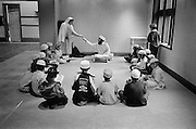 Bradford, in Yorkshire, is home to  the largest Muslim polulatiuon in Britain with some 75,000 lured by employment offered in the mills in the 1950's. Asian Muslims make up 18% of the population and there are sixty mosques in the town.<br /> Children studying the Koran, Victor Street Mosque, Manningham.