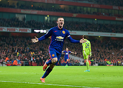 LONDON, ENGLAND - Saturday, November 22, 2014: Manchester United's Wayne Rooney celebrates scoring the second goal against Arsenal during the Premier League match at the Emirates Stadium. (Pic by David Rawcliffe/Propaganda)