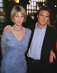 MR ADRIAN GILL and MISS NICOLA FORMBY at a party in London on 29th April 1999.MRO 88
