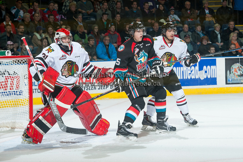 KELOWNA, CANADA - NOVEMBER 22: Tomas Soustal #15 of Kelowna Rockets looks for the pass as Adin Hill #31 of Portland Winterhawks defends the net on November 22, 2014 at Prospera Place in Kelowna, British Columbia, Canada.  (Photo by Marissa Baecker/Shoot the Breeze)  *** Local Caption *** Tomas Soustal; Adin Hill;