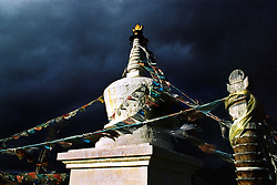 "China, Gyalthang, 2005. A fall storm looms over this well-tended stupa near Gyalthang, the Tibetan name for the town recently renamed ""Shangri La"" by the government.."