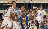 Picture by Ady Kerry/Focus Images Ltd.  .26/09/09.Norwich's Adam Drury celebrates with scorer Darel Russell  during their Coca-Cola League 1 game at the Priestfield Stadium, Gillingham, Kent