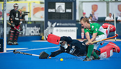 England's George Pinner saves from Michael Watt of Ireland during the penalty shoot-out. Final of the Investec London Cup, Lee Valley Hockey & Tennis Centre, London, UK on 13 July 2014. Photo: Simon Parker