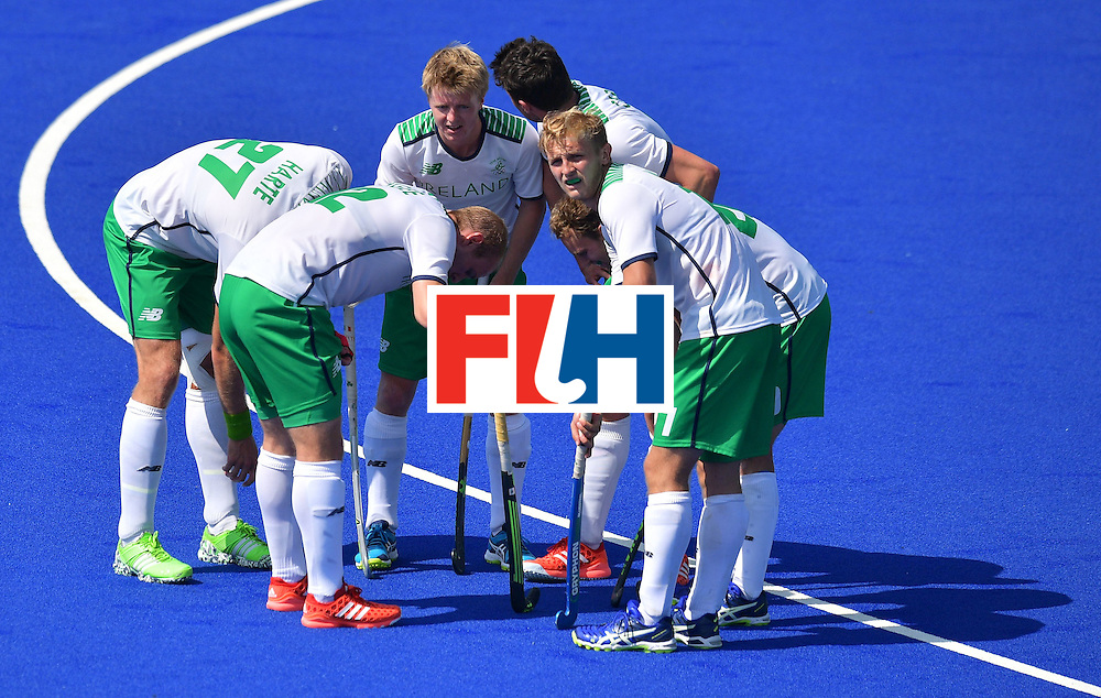 Ireland team members speak on the field during the men's field hockey India vs Ireland match of the Rio 2016 Olympics Games at the Olympic Hockey Centre in Rio de Janeiro on August, 6 2016. / AFP / Carl DE SOUZA        (Photo credit should read CARL DE SOUZA/AFP/Getty Images)