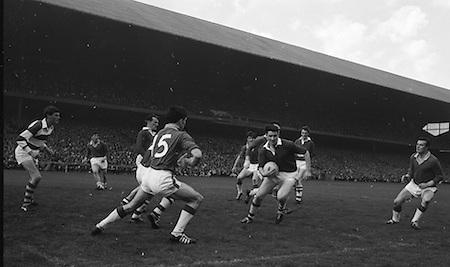 Cork Full back J. Lucey clears ball with Forward O'Shanley on left during the All Ireland Senior Gaelic Football Final Cork v. Meath in Croke Park on the 24th September 1967. Meath 1-9 Cork 0-9.