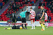 Doncaster Rovers Midfielder Ben Whiteman (12) rechives a yellow card from referee Darren Bond for a foul on Bristol Rovers Midfielder Chris Lines during the EFL Sky Bet League 1 match between Doncaster Rovers and Bristol Rovers at the Keepmoat Stadium, Doncaster, England on 27 January 2018. Photo by Craig Zadoroznyj.