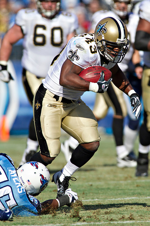 NASHVILLE, TN - DECEMBER 11:   Darren Sproles #43 of the New Orleans Saints is tripped by Akeem Ayers #56 of the Tennessee Titans at LP Field on December 11, 2011 in Nashville, Tennessee.  The Saints defeated the Titans 22-17.  (Photo by Wesley Hitt/Getty Images) *** Local Caption *** Darren Sproles; Akeem Ayers