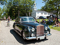Modes of transportation including an antique Rolls Royce, bicycles, horses and tractors joined together for the Sanbornton Old Home Day parade on Saturday.  (Karen Bobotas/for the Laconia Daily Sun)