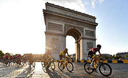 Team Ineos' Egan Bernal (second right) cycles past the Arc De Triomphe during stage 21 of the Tour de France during stage 21 of the Tour de France.