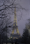 Eiffel Tower at dusk with a pinch of fog.