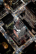The Chrysler Building at an extreme angle from a helicopter. Taken at night by photographer Evan Joseph.