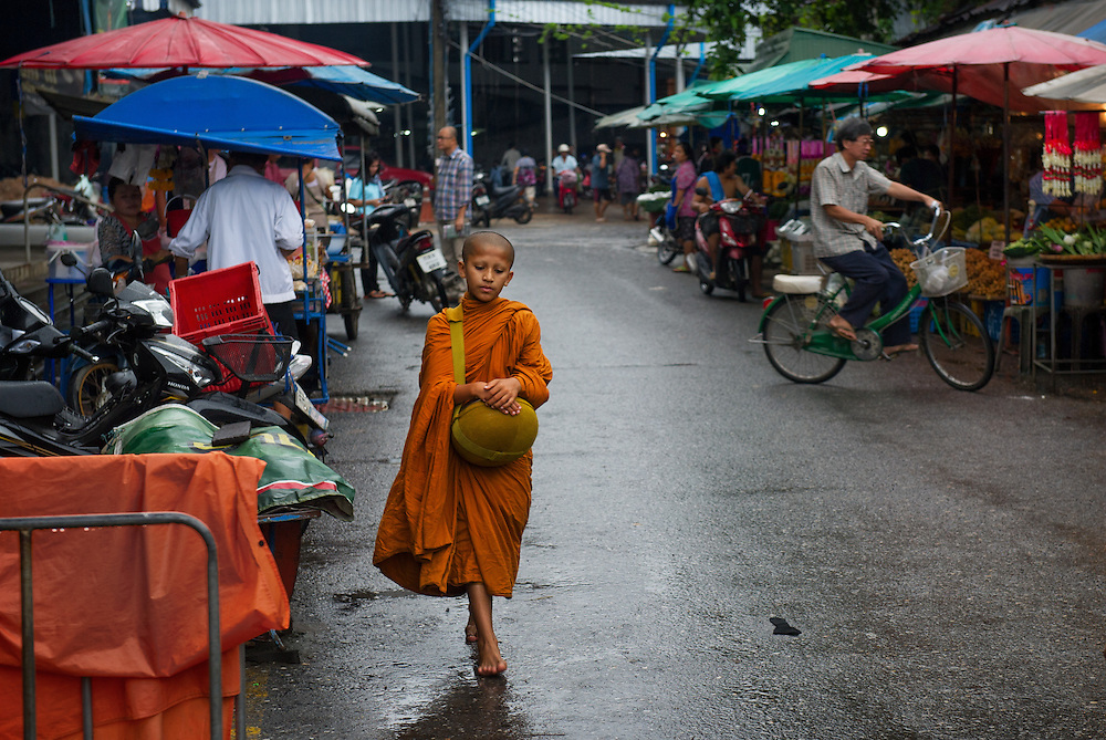 A young monk in the morning market, Nakhon Nayok, Thailand