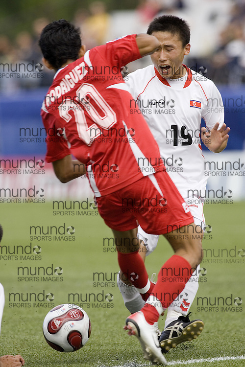 30 June 2007 (Ottawa) -- People's Republic of Korea (PRK) versus Panama (PAN) group stage game in the FIFA U-20 World Cup Canada 2007...Kyong Il Kim chases the ball against Panama...Photo credit Sean Burges/Mundo Sport Images.
