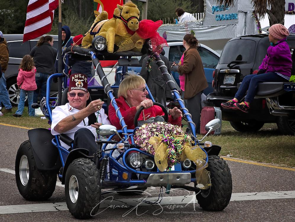 Members of the Ansar Shriners participate in the Krewe de la Dauphine Mardi Gras Parade, Jan. 28, 2017, in Dauphin Island, Alabama.  (Photo by Carmen K. Sisson/Cloudybright)