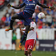 Dominic Oduro, Chicago Fire, out jumps Tim Cahill, New York Red Bulls, for the ball during the New York Red Bulls V Chicago Fire Major League Soccer regular season match at Red Bull Arena, Harrison. New Jersey. USA. 6th October 2012. Photo Tim Clayton