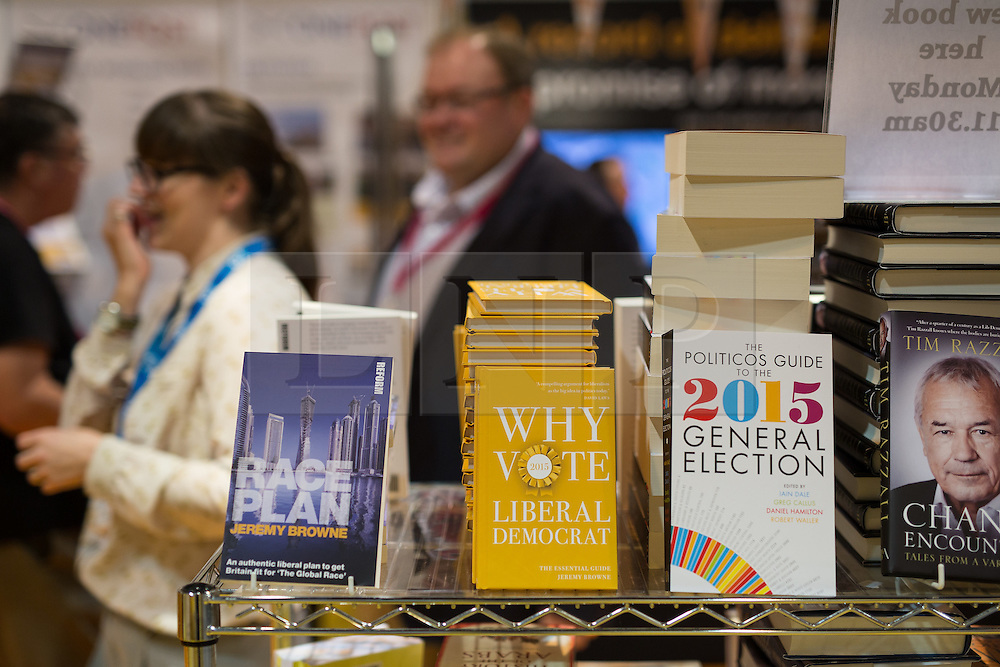"""© Licensed to London News Pictures . 04/10/2014 . Glasgow , UK . """" Why vote Liberal Democrat """" for sale in the exhibition hall at the conference . The Liberal Democrat Party Conference 2014 at the Scottish Exhibition and Conference Centre in Glasgow . Photo credit : Joel Goodman/LNP"""