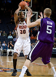 Virginia forward Adrian Joseph (30) passes over Northwestern guard-forward Jeff Ryan (5).  Virginia safety Nate Lyles (30)The Virginia Cavaliers men's basketball team faced the Northwestern Wildcats at John Paul Jones Arena in Charlottesville, VA on November 27, 2007.