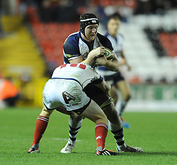 Bristol Rugby blindside flanker, Nick Koster is challenged by London Scottish fly half, new signing Connor Braid - Photo mandatory by-line: Dougie Allward/JMP - Mobile: 07966 386802 - 05/12/2014 - SPORT - Rugby - Bristol - Ashton Gate - Bristol Rugby v London Scottish - B&I Cup