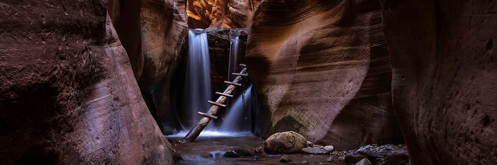 A makeshift ladder leads to the top of a small waterfall deep in one of Southern Utah's slot canyons.