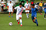 Team USA forward Osvaldo Reyes (7) fights to keep possession of the ball from Team Guatemala midfielder Diego Villatoro (5) during a CONCACAF boys under-15 championship soccer game, Monday, Aug. 5, 2019, in Bradenton, Fla. The USA defeated Guatemala  2-0 (Kim Hukari/Image of Sport)