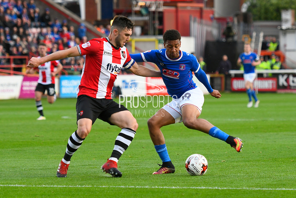 Jordan Moore-Taylor (15) of Exeter City battles for possession with Reggie Lambe (19) of Carlisle United during the EFL Sky Bet League 2 play off second leg match between Exeter City and Carlisle United at St James' Park, Exeter, England on 18 May 2017. Photo by Graham Hunt.