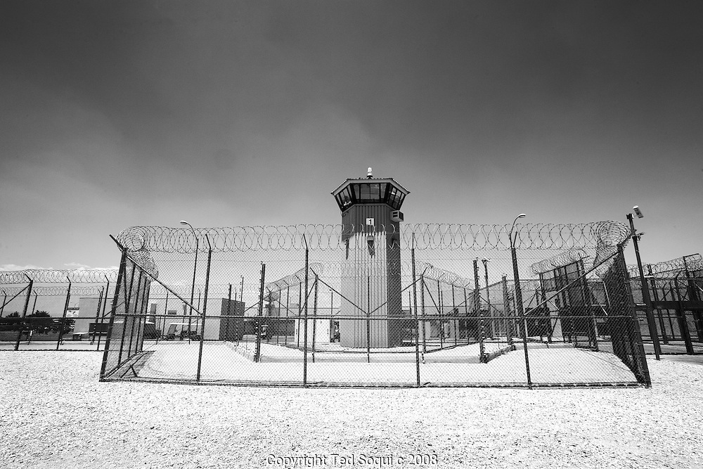 A guard tower with an electrified fence..California State Prison, Los Angeles County.