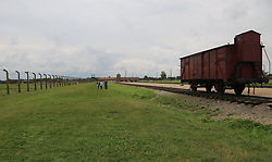 A Deutsche Reichsbahn 'Gueterwagen' (goods wagon), one type of rail car used for deportations at the Auschwitz-Birkenau Nazi concentration camps in Auschwitz, Poland on September 3, 2017. Auschwitz concentration camp was a network of German Nazi concentration camps and extermination camps built and operated by the Third Reich in Polish areas annexed by Nazi Germany during WWII. It consisted of Auschwitz I (the original camp), Auschwitz II–Birkenau (a combination concentration/extermination camp), Auschwitz II–Monowitz (a labor camp to staff an IG Farben factory), and 45 satellite camps. In September 1941, Auschwitz II–Birkenau went on to become a major site of the Nazi Final Solution to the Jewish Question. From early 1942 until late 1944, transport trains delivered Jews to the camp's gas chambers from all over German-occupied Europe, where they were killed en masse with the pesticide Zyklon B. An estimated 1.3 million people were sent to the camp, of whom at least 1.1 million died. Around 90 percent of those killed were Jewish; approximately 1 in 6 Jews killed in the Holocaust died at the camp. Others deported to Auschwitz included 150,000 Poles, 23,000 Romani and Sinti, 15,000 Soviet prisoners of war, 400 Jehovah's Witnesses, and tens of thousands of others of diverse nationalities, including an unknown number of homosexuals. Many of those not killed in the gas chambers died of starvation, forced labor, infectious diseases, individual executions, and medical experiments. In 1947, Poland founded a museum on the site of Auschwitz I and II, and in 1979, it was named a UNESCO World Heritage Site. Photo by Somer/ABACAPRESS.COM