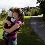 Oslo, Norway, August 25, 2012. Hanna, teacher, 36 years old, with her two children Anna, almost three years and Anton, 3 months. Hannah has decided to share 57 weeks of parental leave with her partner Kai. Norway has one of the most generous<br />