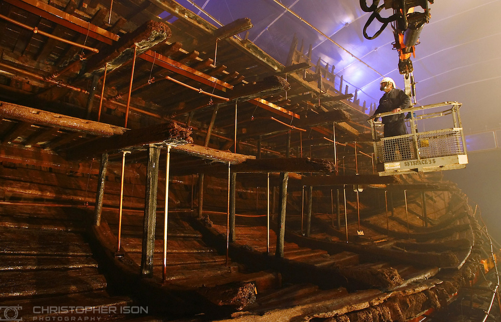 Ship Hall Engineer Tony Marsland inspects the jets which spray the hull of Henry VIII's famous warship, the Mary Rose with preserving fluid. The remains of the Tudor vessel sit in an atmospherically controlled dry dock in Portsmouth's historic dockyard.