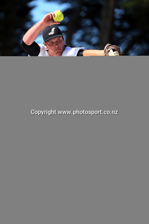 Pitcher Kurt Schollum of the Black Sox inaction during game three of the Trans Tasman Softball Series between the New Zealand Black Sox and the Australian Steelers at Tradestaff Rosedale Park in Albany, Auckland on 29 March 2014. Photo: Jason Oxenham / www.photosport.co.nz