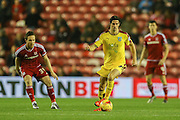 Burnley midfielder George Boyd  watched by Middlesbrough midfielder Adam Forshaw  during the Sky Bet Championship match between Middlesbrough and Burnley at the Riverside Stadium, Middlesbrough, England on 15 December 2015. Photo by Simon Davies.