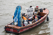 UNITED KINGDOM, London: 16 April 2019 <br /> Extinction Rebellion supporters show their solidarity from their boat as protests continue on Waterloo Bridge today. It is the second day of protests that have appeared in five locations across the city. Police officers have made more than 120 arrests in the last 24 hours.<br /> Rick Findler / Story Picture Agency