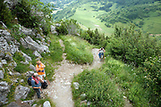 elderly people climbing up a mountain