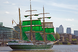 © Licensed to London News Pictures. 17/05/2015.  A tall ship passed through iconic Tower Bridge  on a warm, sunny May sunday. The German vessel Alexander von Humboldt II had been in London for the weekend. She is known for her distinctive green sails. Credit : Rob Powell/LNP