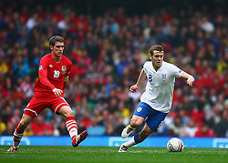 26.03.2011, Millenium Stadium, Cardiff, ENG, EURO 2012 Qualifikation, England vs Wales, im Bild Action with Jack Wilshere of England  and Arsenal Team mate Aaron Ramsey  of Wales    during Wales vs England at the Millenium Stadium in Cardiff for the Euro 2012 qualification, group G  on 26/03/2011. EXPA Pictures © 2011, PhotoCredit: EXPA/ IPS/ Marcello Pozzetti +++++ ATTENTION - OUT OF ENGLAND/UK and FRANCE/FR +++++