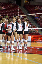 30 August 2011: Redbird volleyball team huddles for a quick celebration during an NCAA volleyball match between the Cougars of Southern Illinois Edwardsville and the Illinois State Redbirds at Redbird Arena in Normal Illinois.