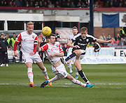 Dundee&rsquo;s Greg Stewart fies in a shot despite the challenge of Ross County&rsquo;s Paul Quinn - Dundee v Ross County - Ladbrokes Premiership at Dens Park<br /> <br />  - &copy; David Young - www.davidyoungphoto.co.uk - email: davidyoungphoto@gmail.com