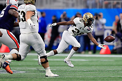 UCF Knights wide receiver Otis Anderson (26) reaches to the ball during the 2018 Chick-fil-A Peach Bowl NCAA football game against the Auburn Tigers on Monday, January 1, 2018 in Atlanta. (Paul Abell / Abell Images for the Chick-fil-A Peach Bowl)