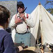 Gary Brown demonstrates a pistol to Keith Hardison, 9, Sunday February 8, 2015 during the 10th Annual Civil War Living History Weekend at Cameron Art  Museum. The Weekend commemorated the Battle of Forks Road. (Jason A. Frizzelle)