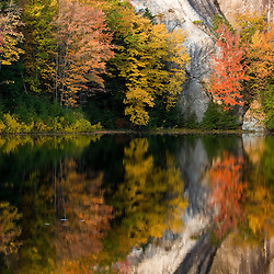 Fall foliage and the cliff at Stonehouse Pond in Barrington.