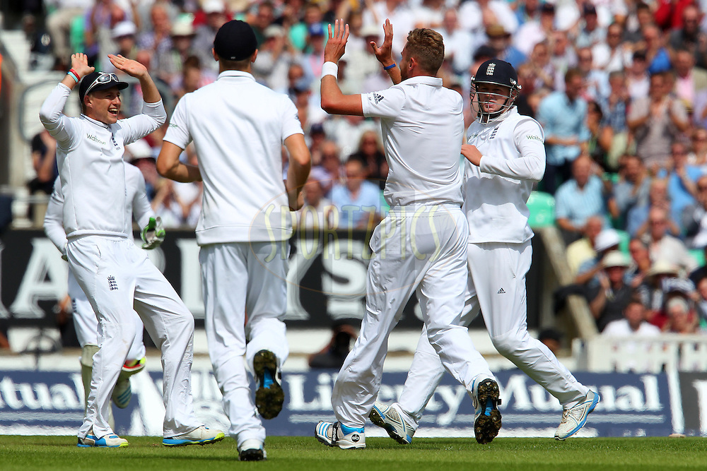 Stuart Broad of England celebrates the wicket of Cheteshwar Pujara of India during day one of the fifth Investec Test Match between England and India held at The Kia Oval cricket ground in London, England on the 15th August 2014<br /> <br /> Photo by Ron Gaunt / SPORTZPICS/ BCCI