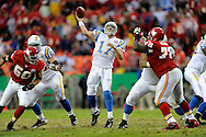 October 25, 2009:   Quarterback Phillip Rivers #17 of the San Diego Chargers throws the ball down field against pressure from defenders Mike Vrabel #50 and Glenn Dorsey #72 of the Kansas City Chiefs in the second quarter at Arrowhead Stadium in Kansas City, Missouri.  The Chargers defeated the Chiefs 37-7...